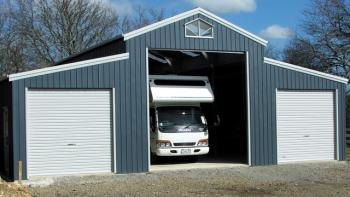 American barn with 3 roller doors fair dinkum sheds American barn style kit homes